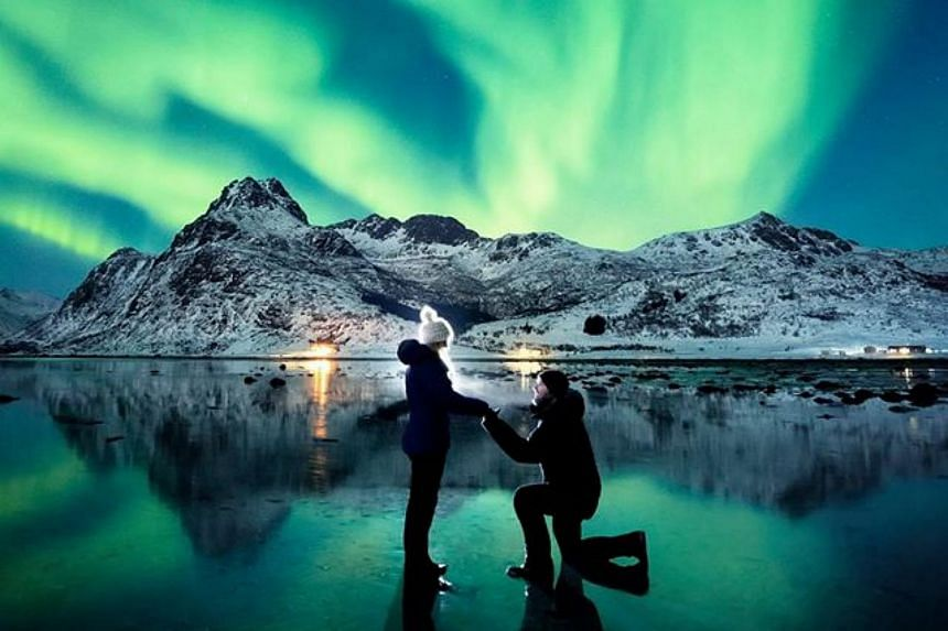 When the Aurora started glowing, photographer Dale Sharpe decided that it was the perfect time to propose to his girlfriend Karlie Russell.