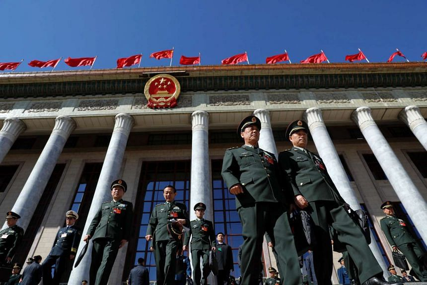 Military delegates leaving the Great Hall of the People after the third plenary session of the National People's Congress in Beijing, China, on March 12, 2017.