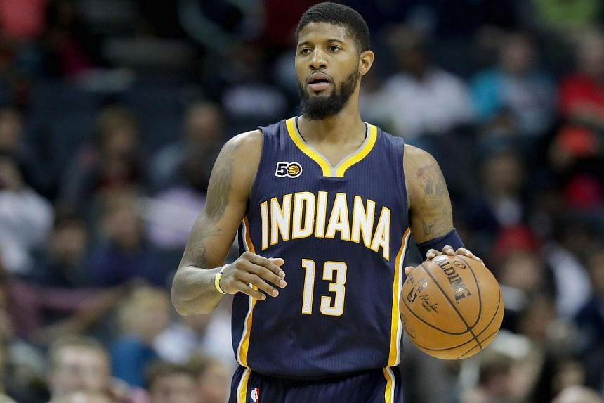 Paul George #13 of the Indiana Pacers brings the ball up against the Charlotte Hornets during their game, on March 6, 2017.