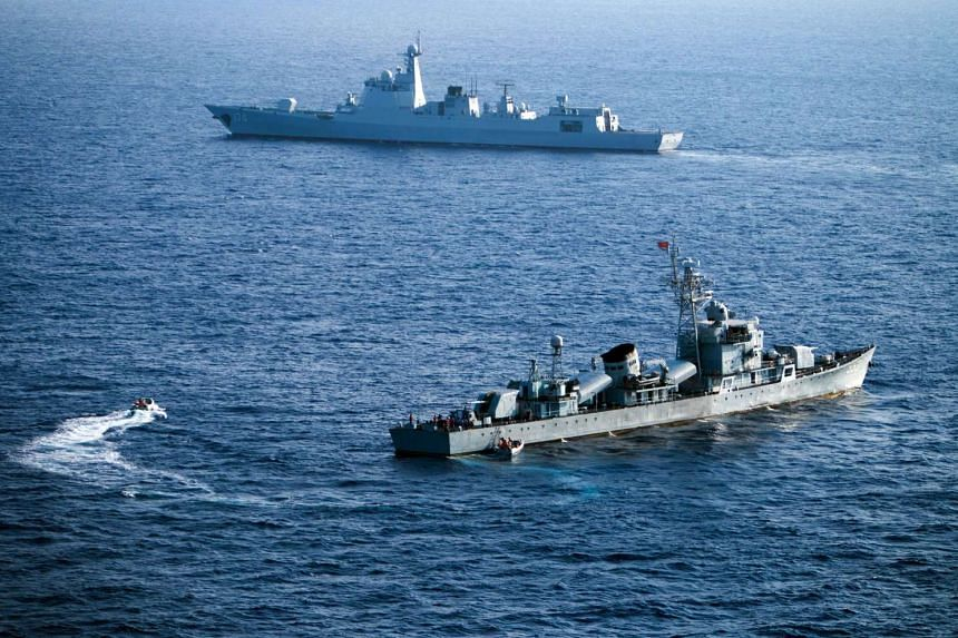 Crew members of China's South Sea Fleet taking part in a drill in the Xisha Islands, or the Paracel Islands, in the South China Sea on May 5, 2016.