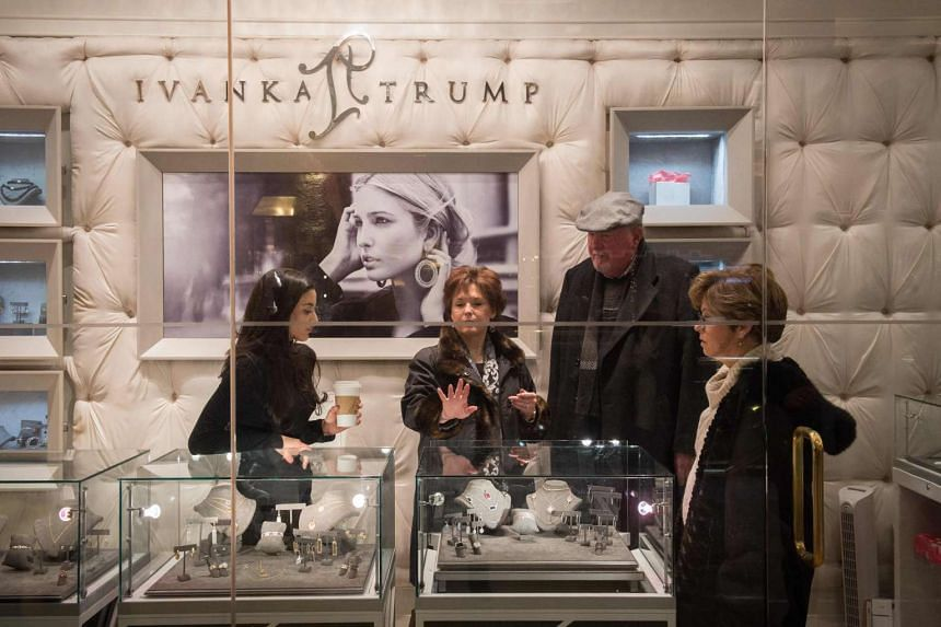 A woman looks over rings for sale at the Ivanka Trump store in Trump Tower in New York.