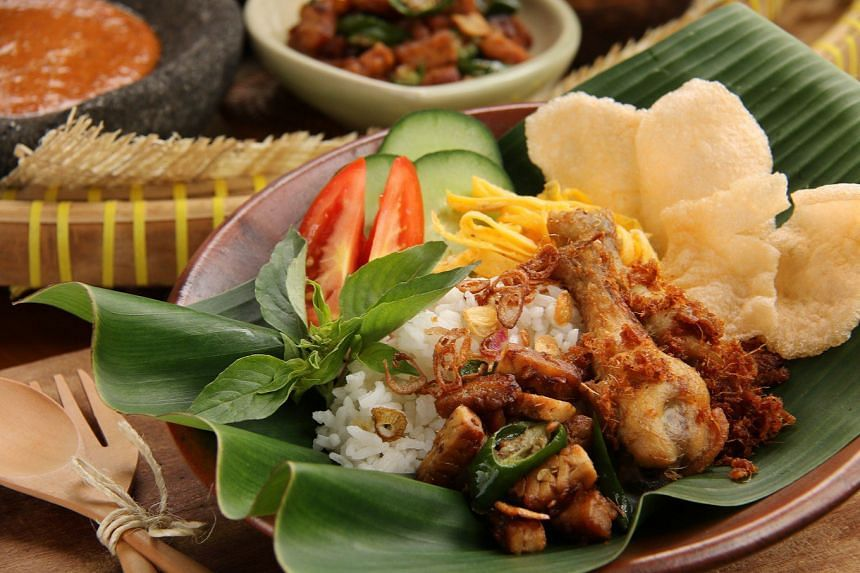 Nasi uduk betawi is one of many typical breakfast dishes in Indonesia.