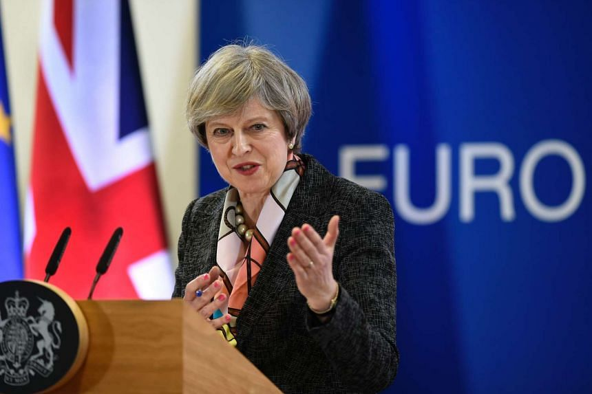 British PM Theresa May speaking at the EU headquarters in Brussels on March 9, 2017.