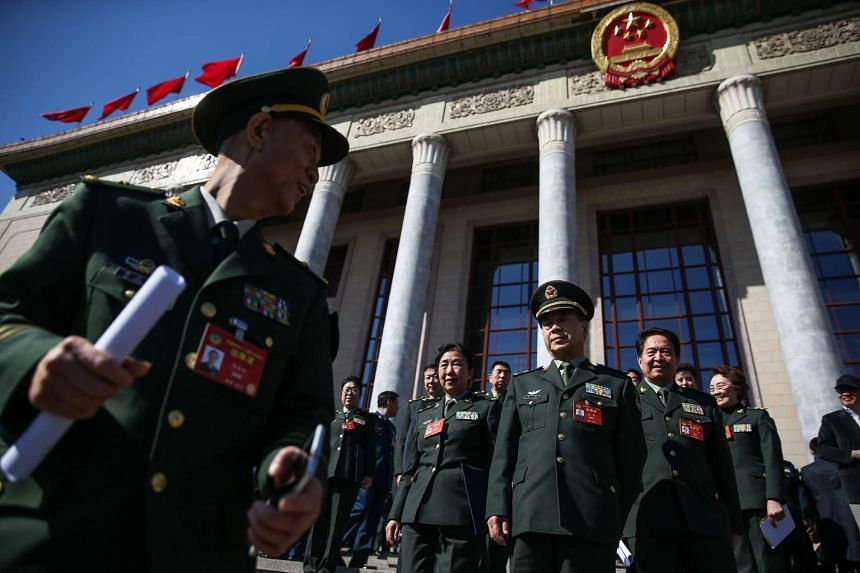 Military delegates leaving the Great Hall of the People (GHOP) after the closing of the Fifth Session of the 12th National Committee of the Chinese People's Political Consultative Conference (CPPCC) in Beijing, China,