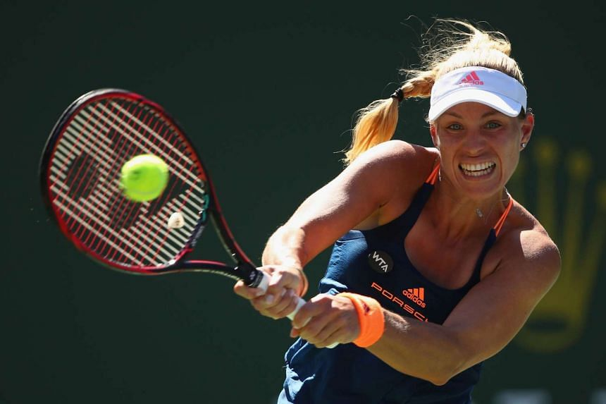 Angelique Kerber of Germany plays a backhand against Pauline Parmentier of France in their third round match during day eight of the BNP Paribas Open at Indian Wells Tennis Garden on March 13, 2017.