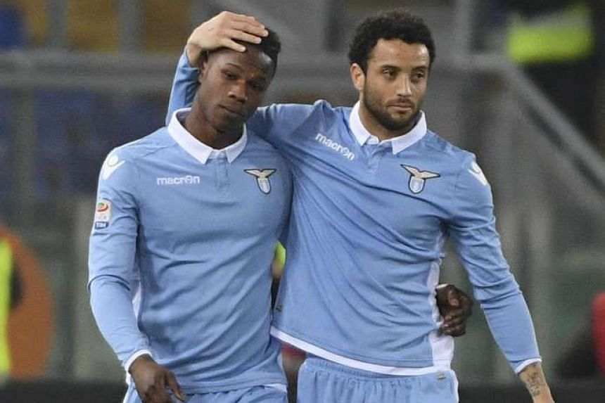 Lazio's forward Keita Balde (left) with his teammate Felipe Anderson after scoring a goal during the Italian Serie A soccer match between Lazio and Torino at the Olimpico stadium in Rome on March 13, 2017.