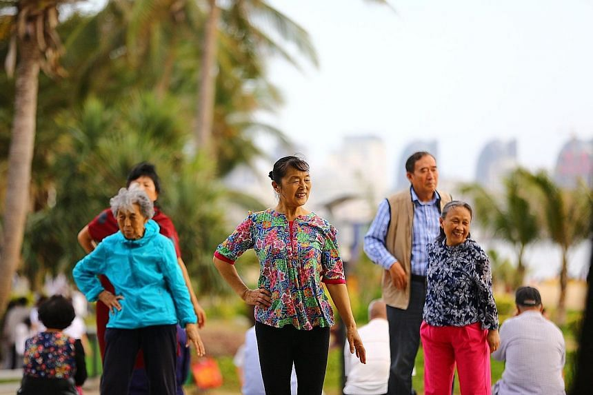 Elderly people at the beach in Sanya, where they have come to escape from the winter discomfort in their home towns in north-east China.