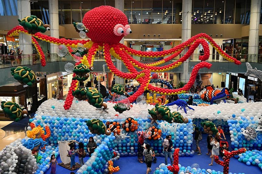 This aquatic wonderland - made with 100,000 inflated balloons - at the Central Atrium of Marina Square was assembled by 45 world-class balloon artists from nine countries. They took four days to complete the display, which features marine creatures s