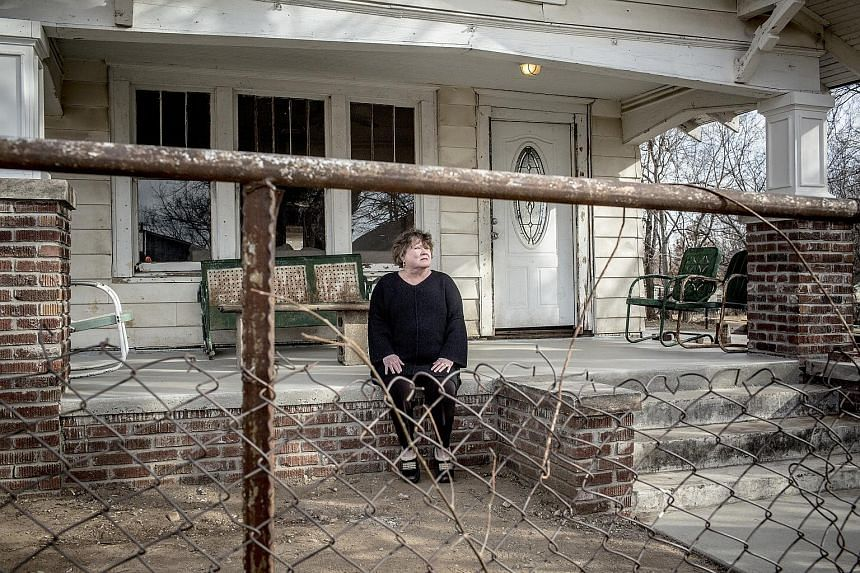Author S.E. Hinton outside the house used as Ponyboy Curtis' home in the 1983 film adaptation of her book The Outsiders. The home in Tulsa, Oklahama, is undergoing renovation as a part of a fan-driven project to turn it into a museum dedicated to the