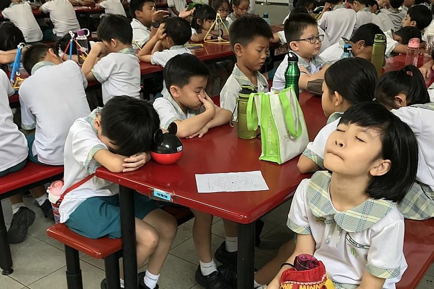 "Pupils at Westwood Primary School in Jurong West participate in a ""mindful breathing"" session in the canteen towards the end of recess every day. These two-minute-long guided breathing sessions were officially introduced in January to help pupils bet"