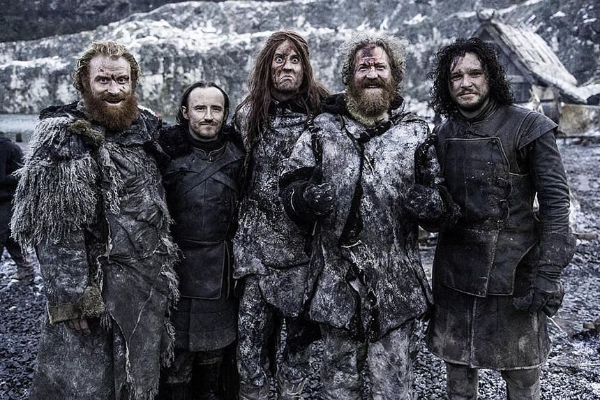 Mastodon (with Ben Crompton, second from left, and Kit Harington, far right) play the wildlings in Season 5.