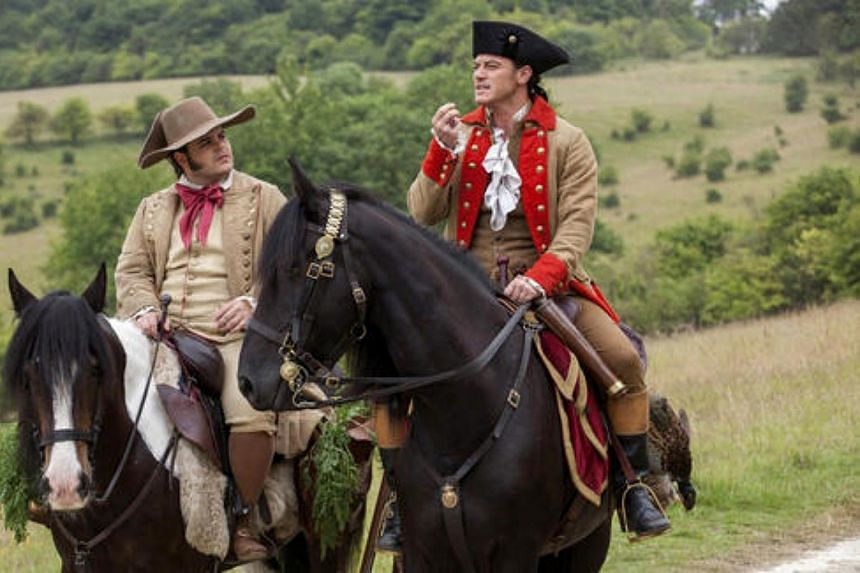 Luke Evans (right) stars as Gaston, and Josh Gad as LeFou in Disney's Beauty And The Beast.