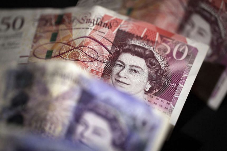 The pound slipped on Tuesday after Britain's parliament paved the way for Prime Minister Theresa May to launch divorce talks with the European Union.