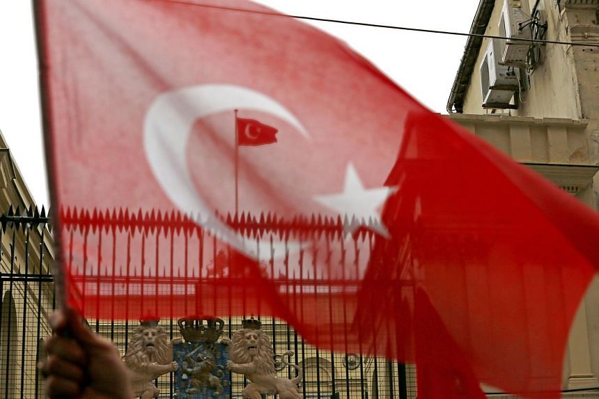 A Turkish flag flies on the roof of the Dutch Consulate during a protest in Istanbul, Turkey, on March 12, 2017.
