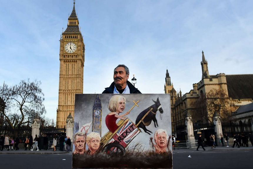 Political satire artist Kaya Mar with his Brexit painting during a protest asas parliament votes on final Brexit Bill on Monday (March 13).