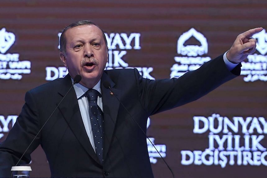 Turkish President Recep Tayyip Erdogan gestures as he speaks in Istanbul on Sunday (March 12, 2017).