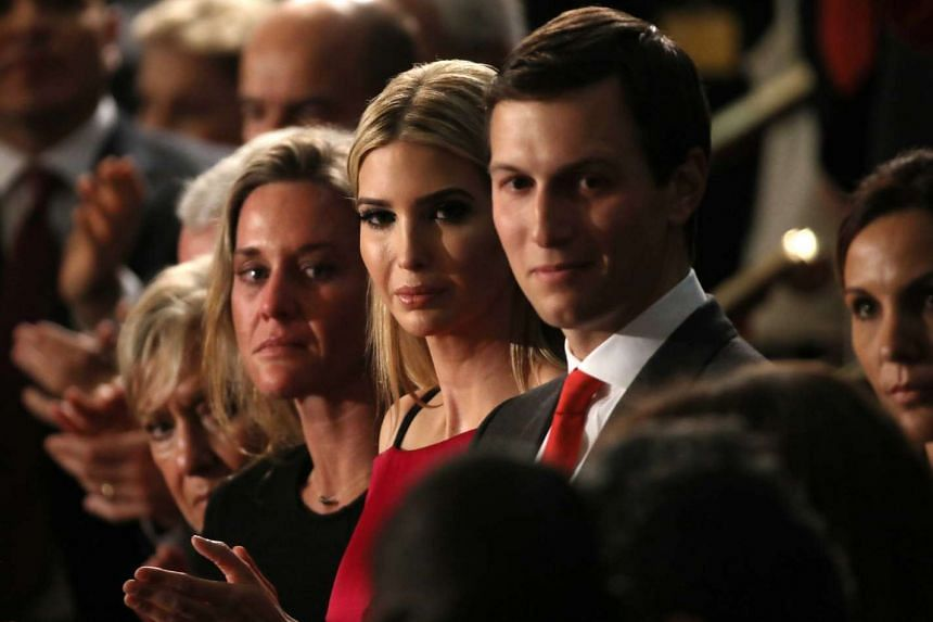 Jared Kushner (right) and his wife  Ivanka Trump (centre) and others applaud President Donald Trump during his speech to the US Congress on Feb 28, 2017.