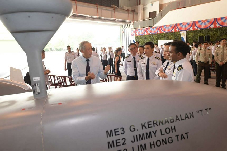 Defence Minister Ng Eng Hen speaking with officers at the ceremony, on March 15, 2017.