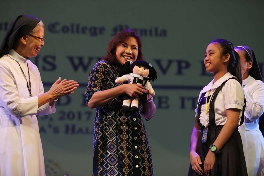 Philippine Vice-President Leni Robredo (centre) speaking during a forum at a Catholic-run school in Manila on March 15, 2017.
