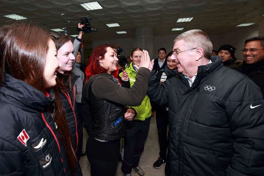 International Olympic Committee President Thomas Bach (right) visiting the athletes' village under constructions in Pyeongchang on March 15, 2017.