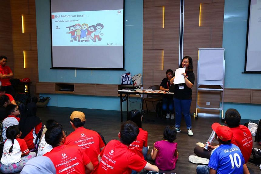 Clara leads an activity for Youth Corps Singapore.