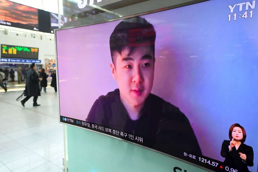 Television news, broadcast at a railway station in Seoul, showing a video footage of a man who claims to be Mr Kim Han Sol, on March 8, 2017.
