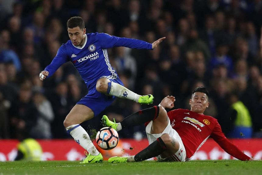 Chelsea's Eden Hazard in action with Manchester United's Marcos Rojo at the FA Cup Quarter Final in Stamford Bridge on March 13, 2017.
