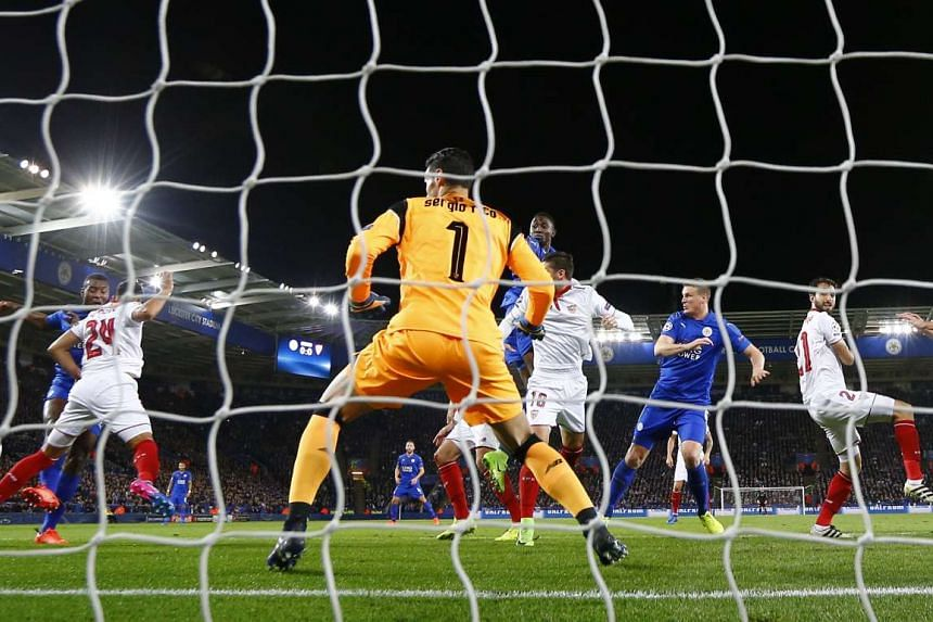 Leicester City's Wes Morgan scoring their first goal.