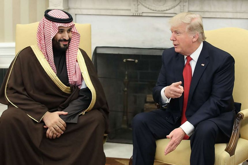 US President Donald Trump speaking with Saudi Arabia's Deputy Crown Prince Mohammed bin Salman in the Oval Office of the White House in Washington, D.C., US, on Tuesday (March 14).