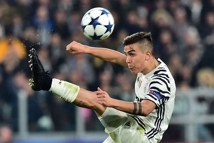 Argentina Paulo Dybala controlling the ball during the Uefa Champions League football match between Juventus and FC Porto, on March 14, 2017.