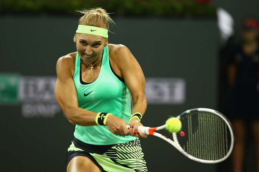 Elena Vesnina plays a backhand against Angelique Kerber in their fourth round match during day nine of the BNP Paribas Open at Indian Wells Tennis Garden on March 14, 2017.
