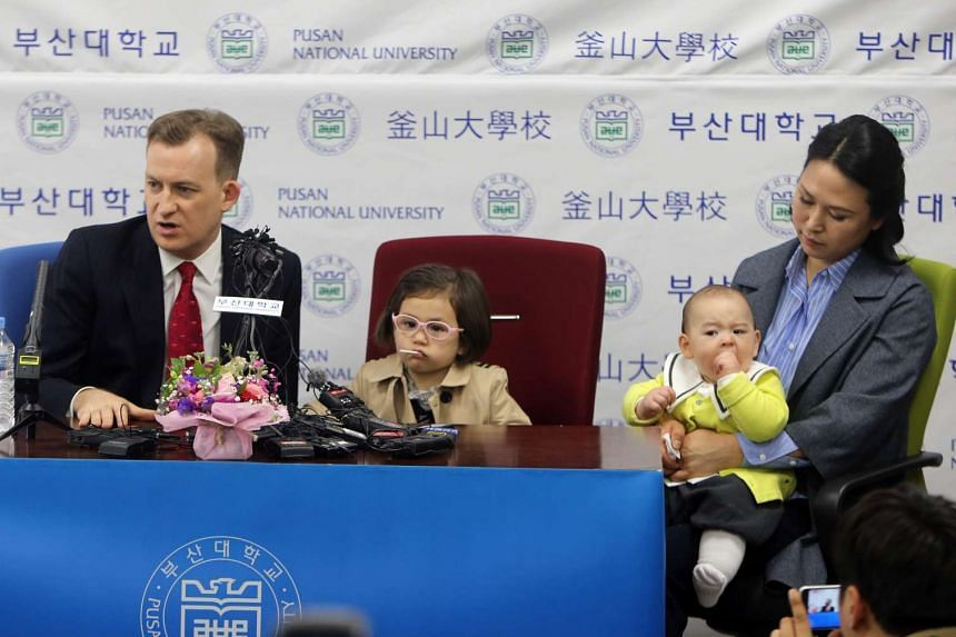 Pusan National University professor Robert Kelly with his wife Kim Jung A, daughter Marion and son James, speaking at a press conference in Busan on March 15, 2017.