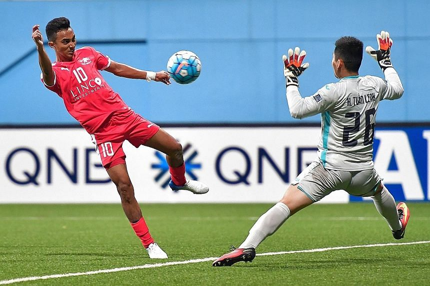 Home United winger Faris Ramli scoring his club's second goal of the night in the 58th minute against Vietnamese side Than Quang Ninh in their AFC Cup group H match at the Jalan Besar Stadium yesterday. Song Ui Young scored a brace in the fourth and