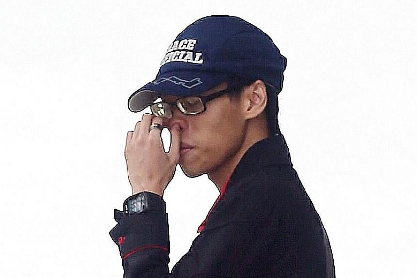 Tan was spotted by a passer-by in Yishun cocking the replica gun before hiding it beneath his clothes.