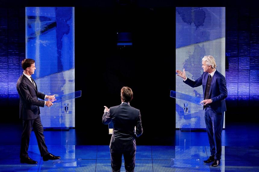 Dutch Prime Minister Rutte (left) facing off against far-right MP Wilders in the televised debate in Rotterdam on Monday.