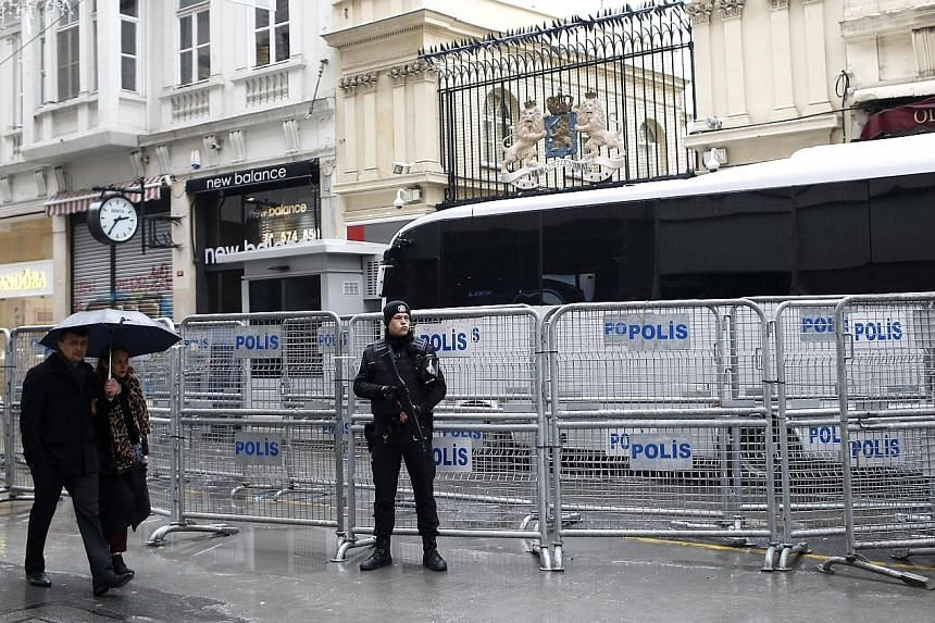 A riot policeman guarding the Dutch consulate in Istanbul on Monday. The Netherlands became embroiled in a row with Turkey after it prevented two Turkish ministers from holding rallies in the country.