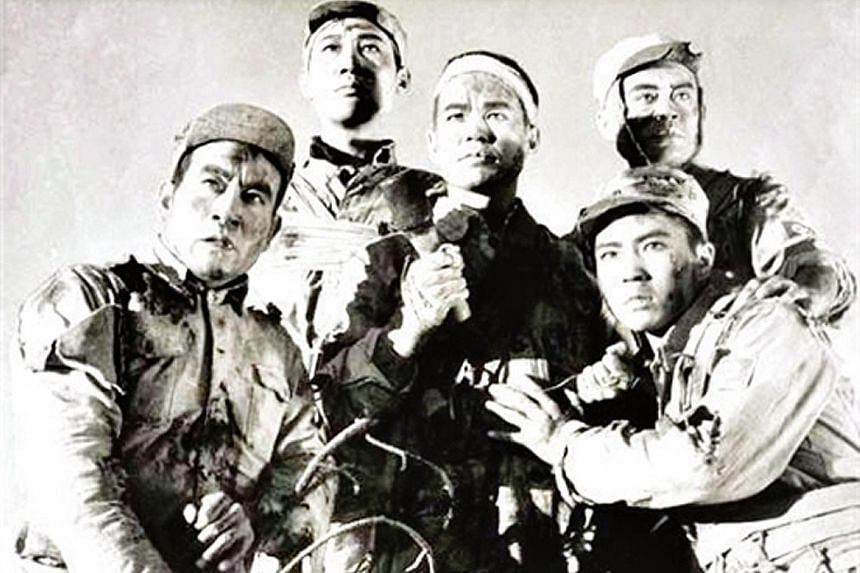 The poster for a 1958 movie about five Communist Party soldiers who refused to surrender to Japanese troops. A historian who questioned whether the men were as heroic as the state has said was ordered to publish an apology last year. The draft provis