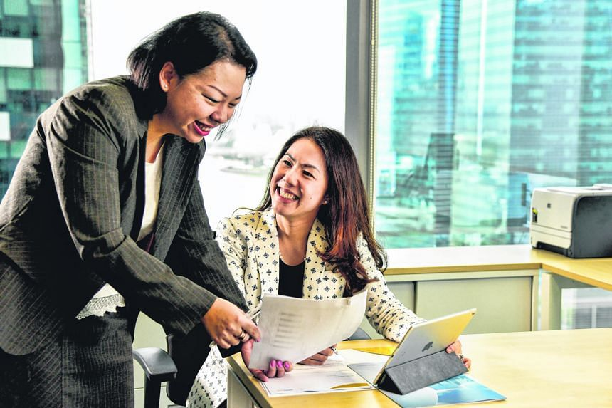 President and head of Asia ex-Japan at Nikko AM, Ms Eleanor Seet (right), with her secretary Rose Lim. The firm is proactive when it comes to helping mothers in their career development and lifestyle needs.