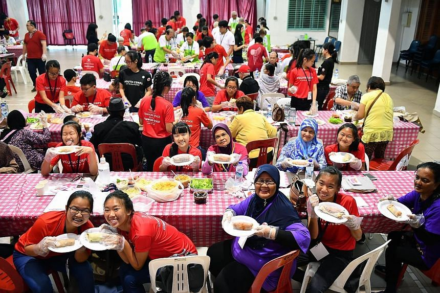 "The young and the old joined hands in Ang Mo Kio yesterday to make 168 rolls of popiah, since the number sounds like ""prosperity all the way"" in Chinese. Eighty students from various schools made the dish with 80 seniors from the Comnet Senior Servic"