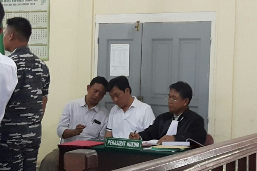 Ricky Tan Poh Hui (second from right) has been charged with trespassing in Indonesian waters in a Tanjung Pinang District Court on March 15, 2017.