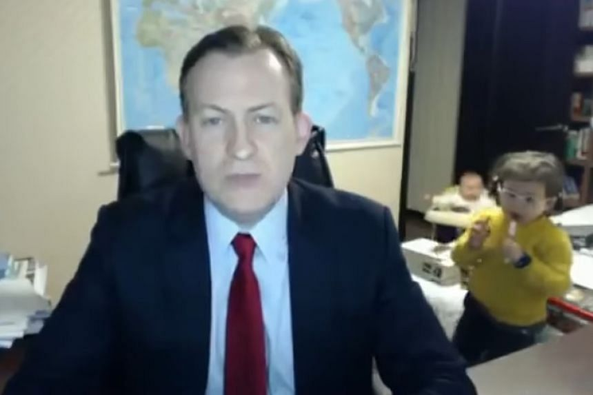 Prof Kelly's children strolled into his study while he was being interviewed for the BBC via Skype.