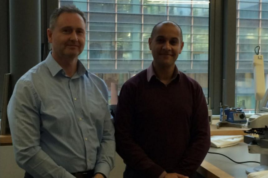Mr Louis Cabena (left) and Mr Deep Singh from Birmingham Optical in the British Library Conservation Centre.