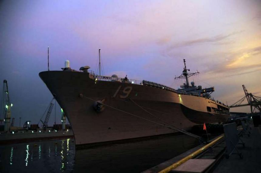 The sun sets behind the USS Blue Ridge - the flagship for the Navy's 7th Fleet - during a port visit to Jakarta, Indonesia.