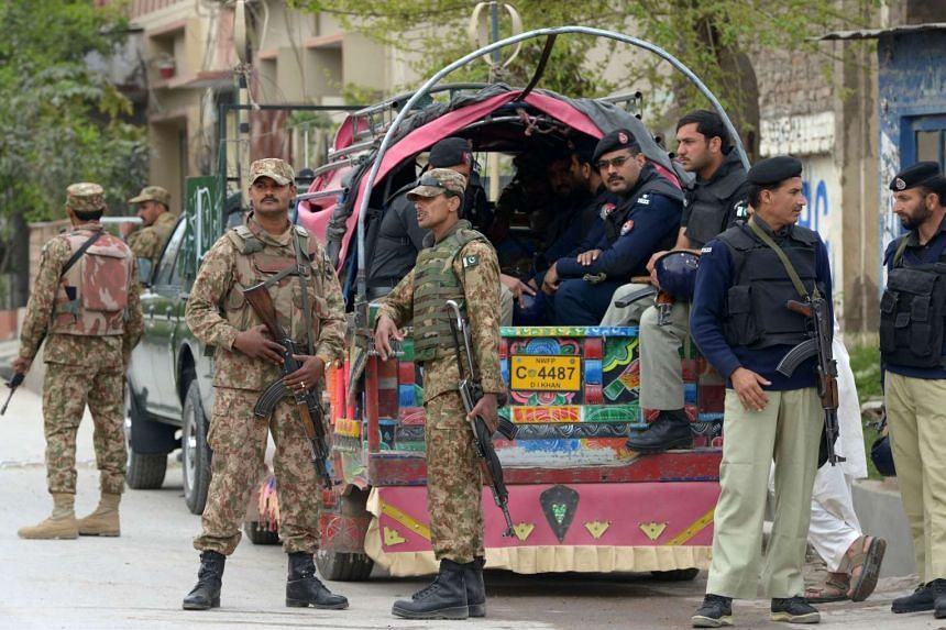 Pakistani soldiers and policemen preparing to leave for a residential area for a census in Peshawar, on March 15, 2017.