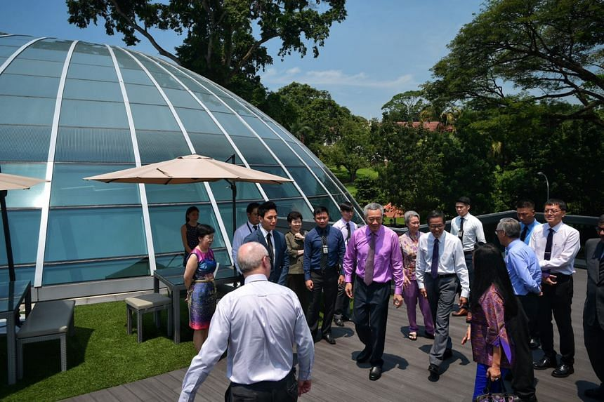 PM Lee Hsien Loong walking outside the Kwa Geok Choo Law Library at the SMU School of Law.