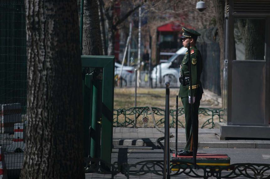 A Chinese paramilitary police officer stands at the entrance of the North Korean embassy in Beijing on March 8, 2017.