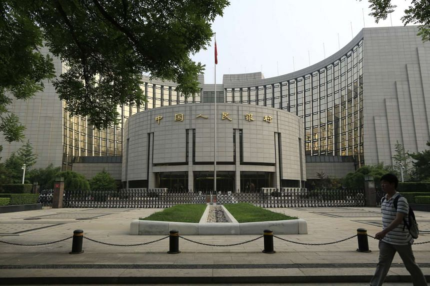 A pedestrian walks past the People's Bank of China in Beijing.