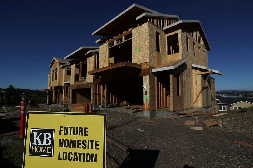 This file photo shows a sign posted in front of a home under construction at a new housing development in Petaluma, California on Nov 16, 2016.