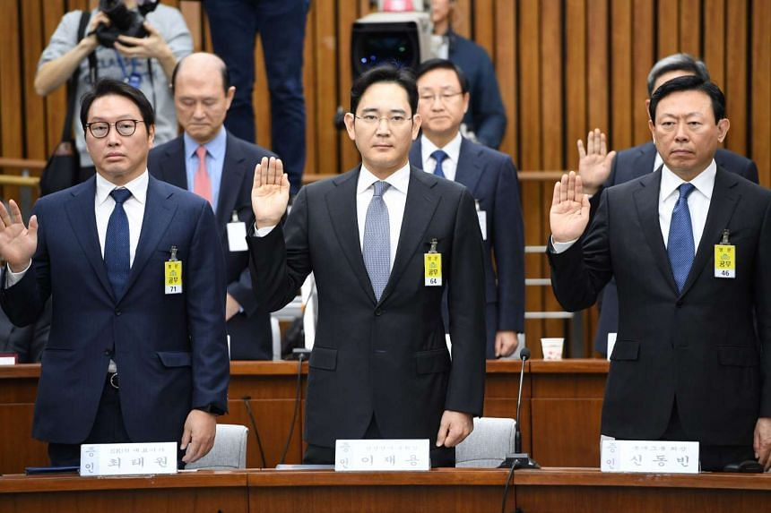SK Group chairman Chey Tae Won (from left), Samsung Group's heir-apparent Lee Jae Yong and Lotte Group Chairman Shin Dong Bin taking an oath during a parliamentary probe into a scandal engulfing President Park Geun Hye at the National Assembly in Seo