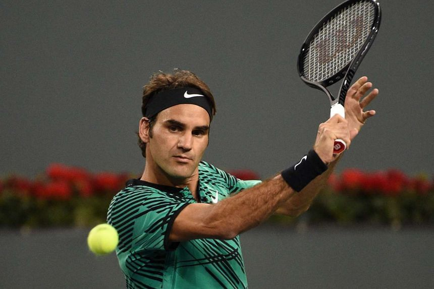 Roger Federer hits a backhand against Stephane Robert of France at the ATP Indian Wells Masters.